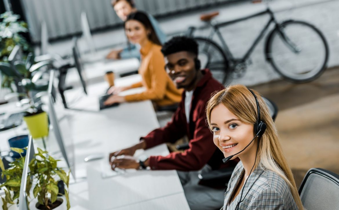 selective focus of multiethnic smiling call center F472XL9