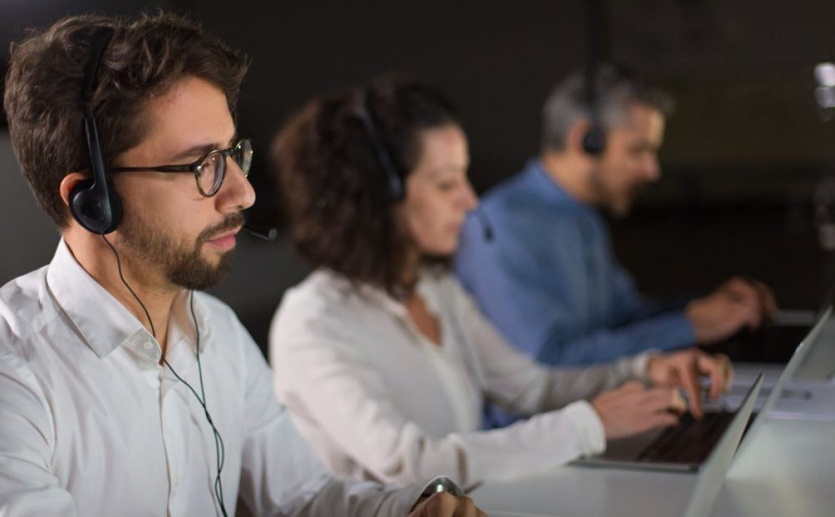concentrated bearded call center operator working
